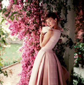 Audrey Hepburn photographed wearing Givenchy by Norman Parkinson, 1955 © Norman Parkinson Ltd/Courtesy Norman Parkinson Archive Audrey